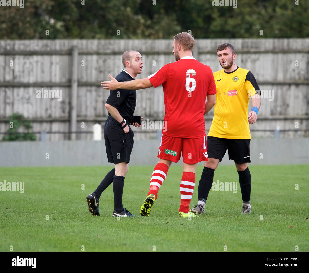 A footballer argues with the ref during the match between New Mills and Oswestry Town on October 14th 2017 at Church - Stock Image