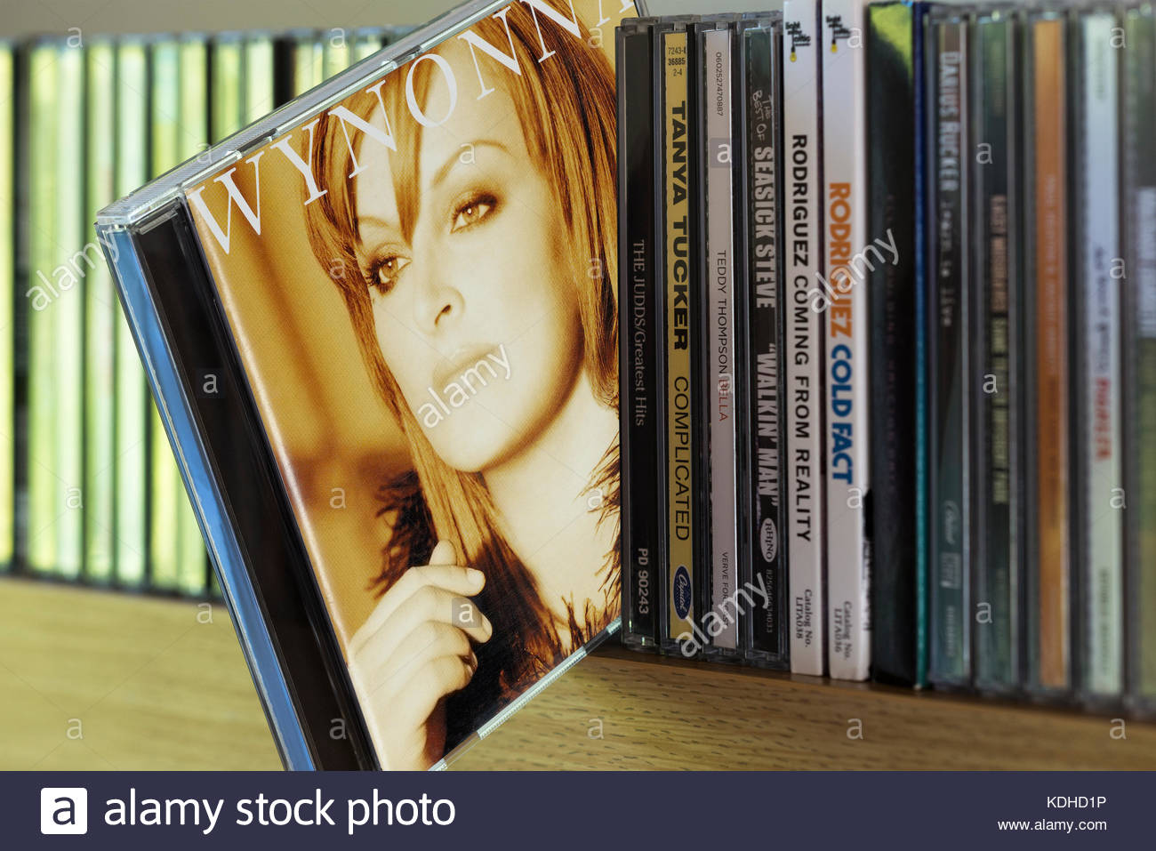 New Day Dawning, Wynonna Judd CD pulled out from among other CD's on a shelf, Dorset, England - Stock Image