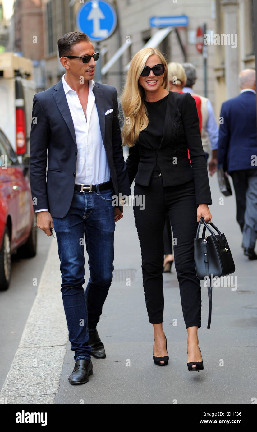 Federica Panicucci And Marco Bacini Out And About In Milan Stock