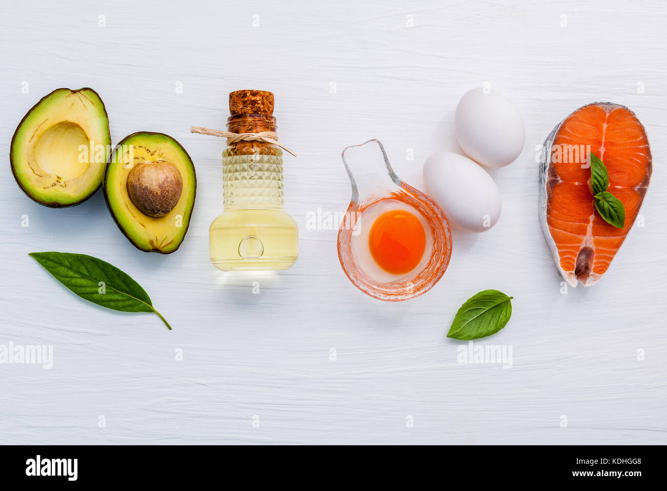 Selection food sources of omega 3 . Super food high omega 3 and unsaturated fats for healthy food. Halve avocado - Stock Image