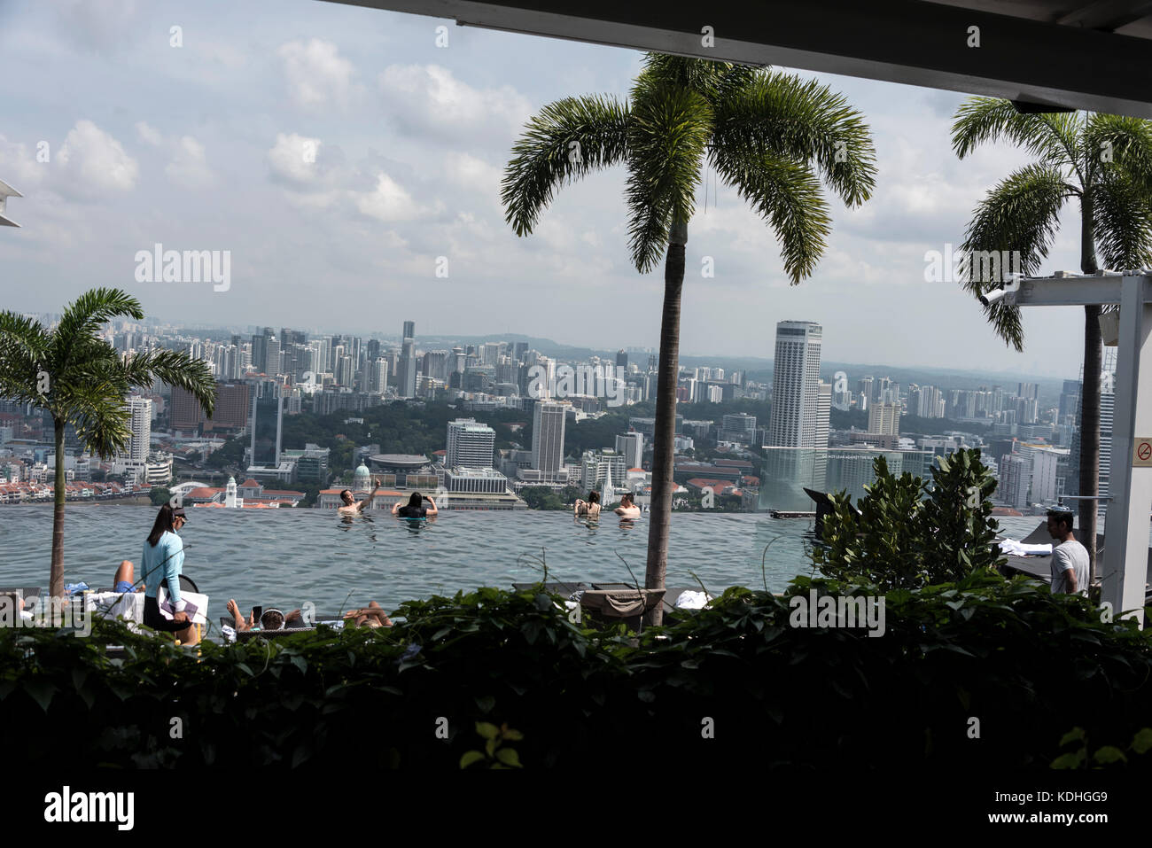 On top of the Marina Bay Sands Hotel, is the world's largest rooftop infinity pool. It offers swimmers a bird's - Stock Image