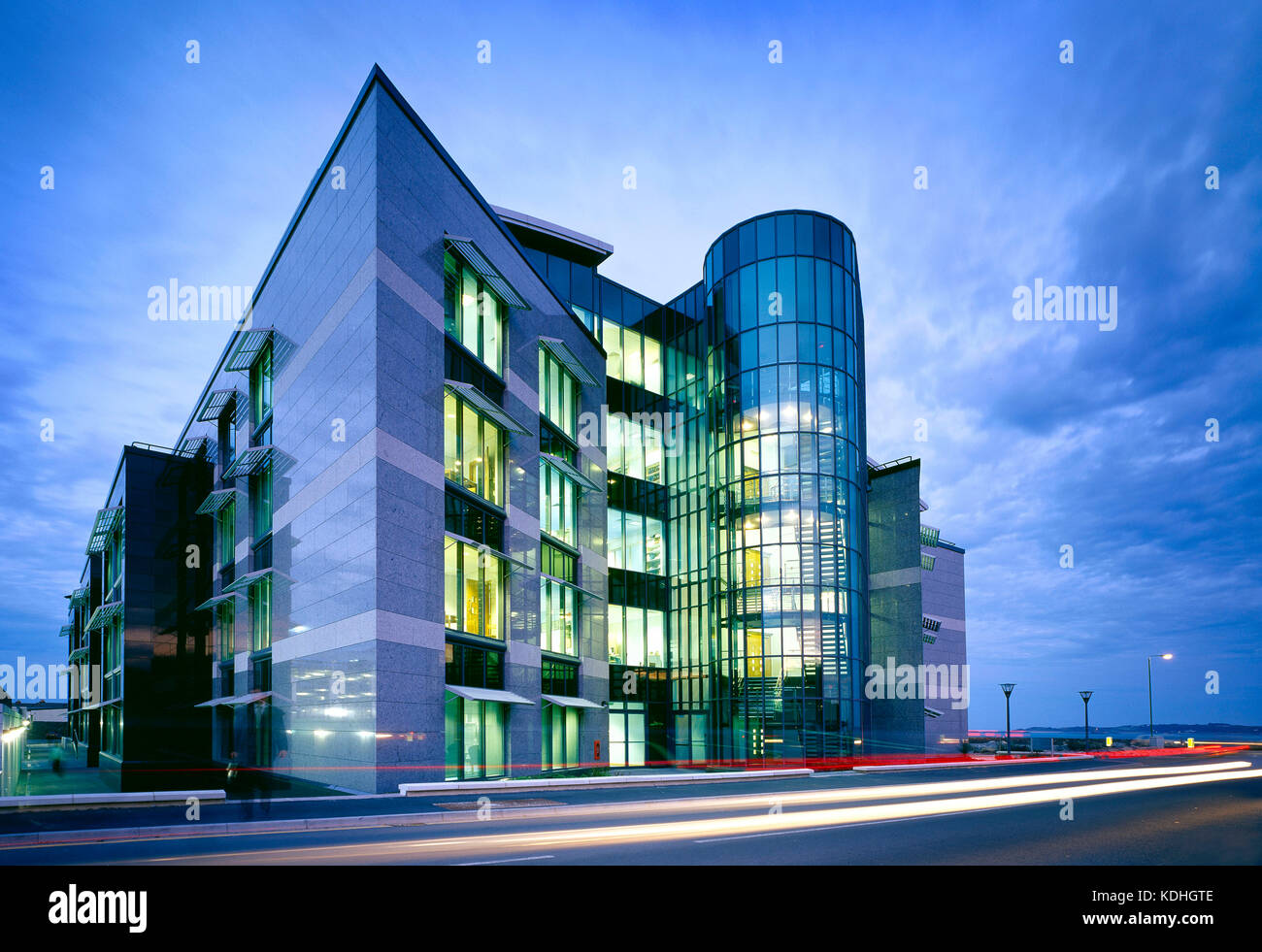 Architecture. Modern commercial building at dusk. Admiral Park Financial District. Saint Peter Port. Guernsey. - Stock Image