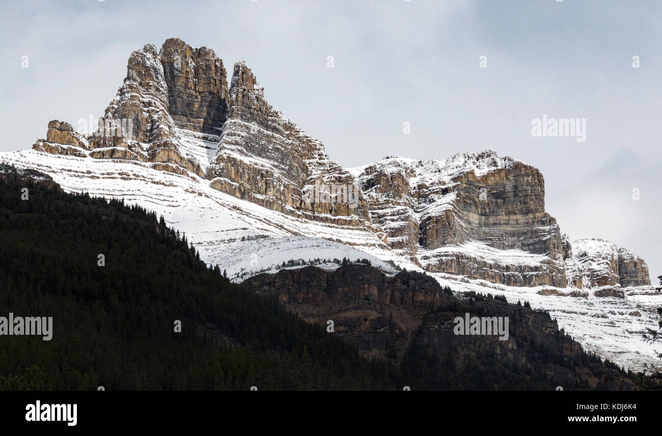 Stoic and snow-covered rock formations in Banff National Park, Alberta, Canada. - Stock Image