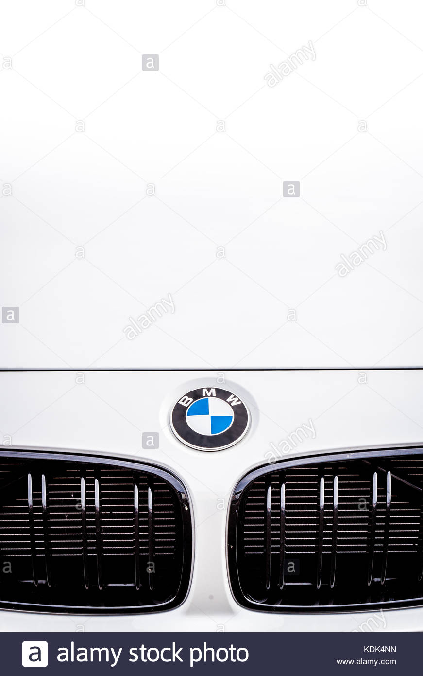 BMW M4 touring sport car front detail, white color and brand logo ...