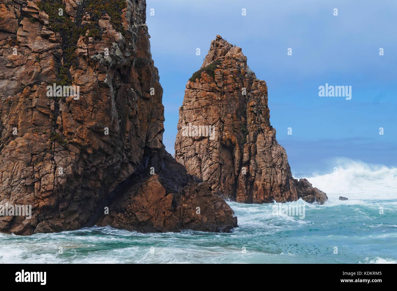 Massive rocks and the raging ocean Stock Photo