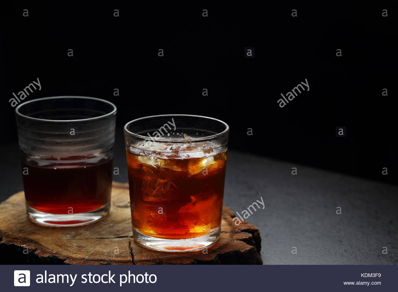 Glasses of hot and cold filter coffee on a wooden board - Stock Image