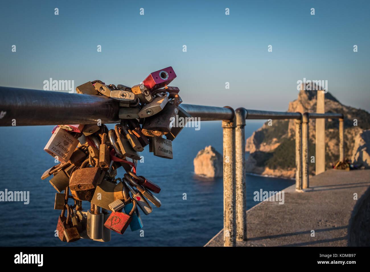 Love padlocks on railing - Stock Image