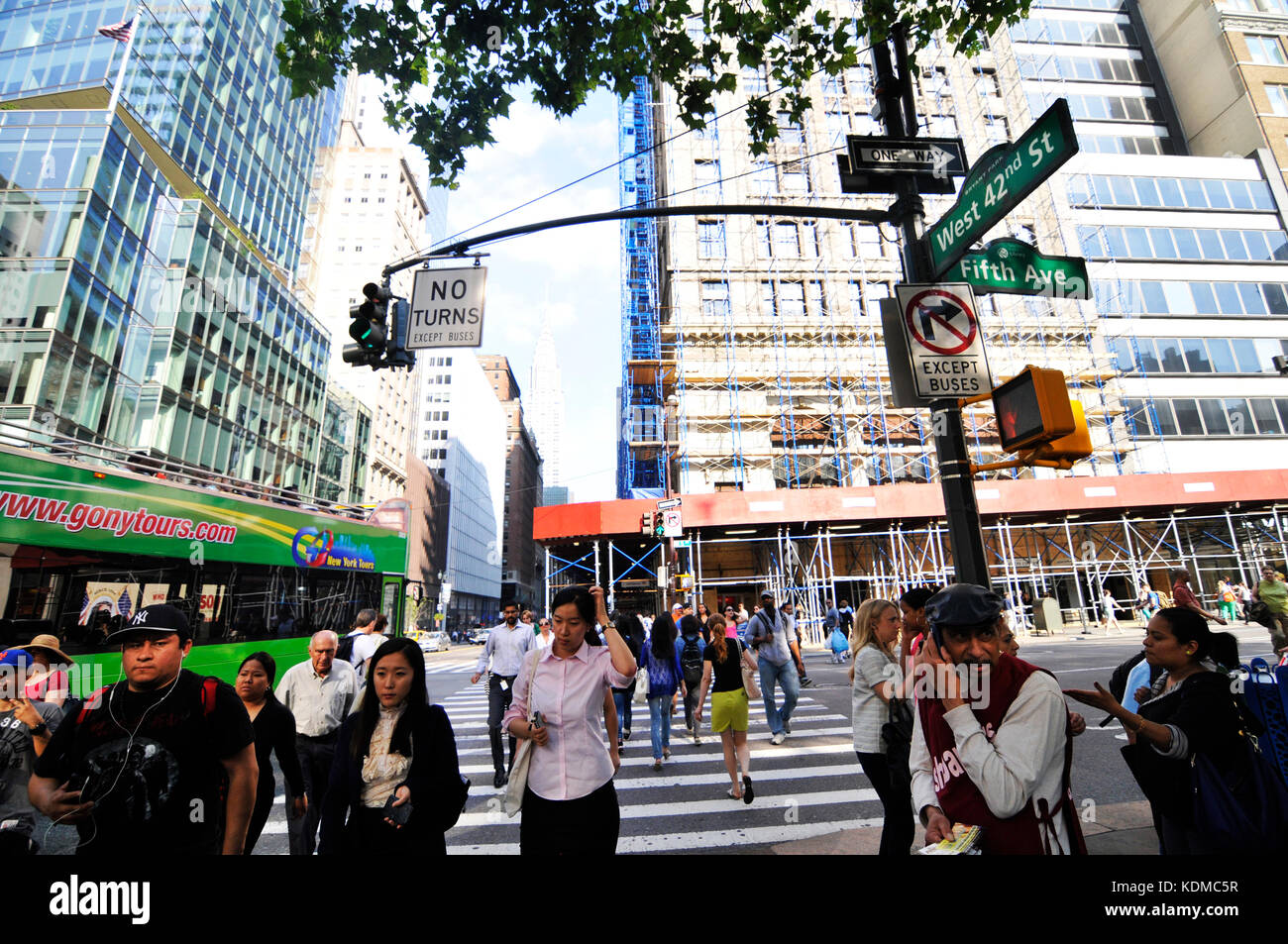 Pedestrians crossing the Fifth Ave along West 42nd St in Manhattan. - Stock Image