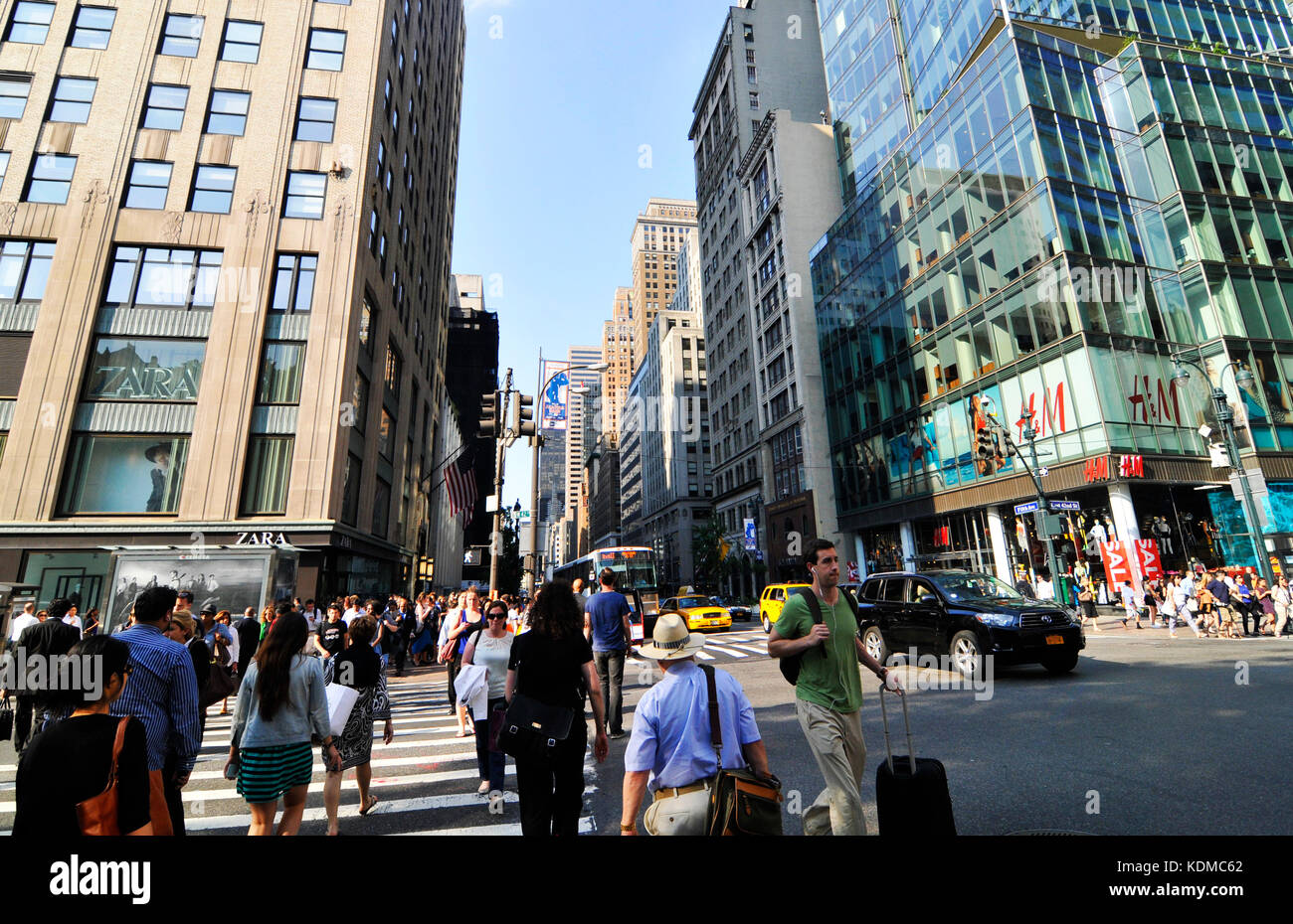 Pedestrians crossing 42nd Street along the 5th Ave in Manhattan. - Stock Image