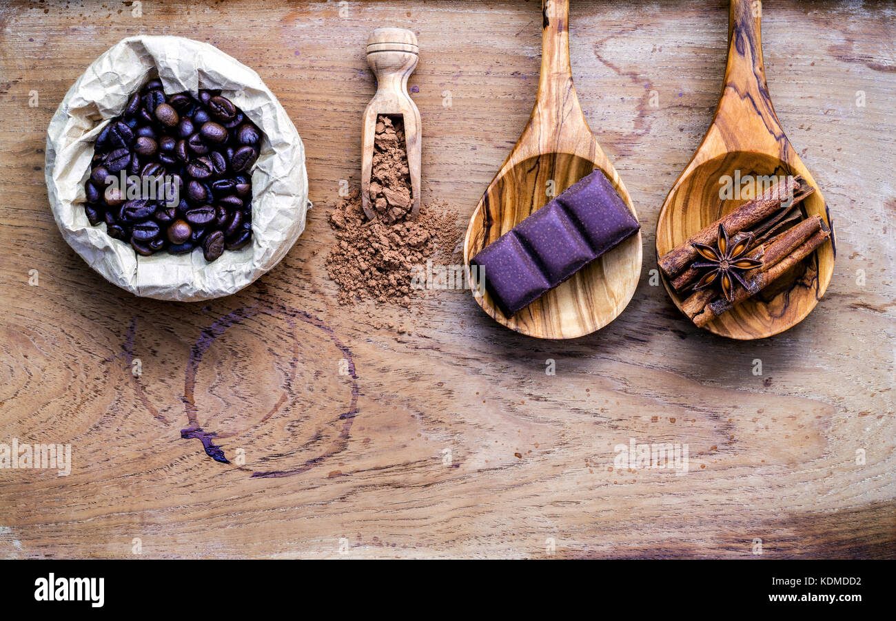 Coffee background and menu design. Ingredients for latte coffee . Roasted coffee beans in paper bag ,chocolate bar Stock Photo