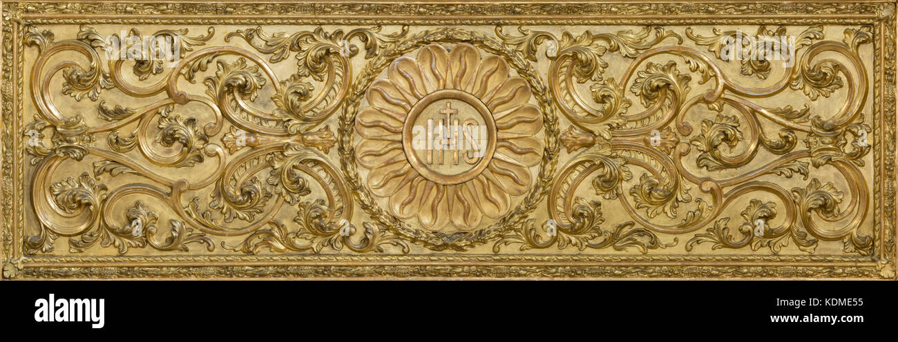 LONDON, GREAT BRITAIN - SEPTEMBER 18, 2017: The carved polychrome baroque relief with the IHS initials on the altar - Stock Image