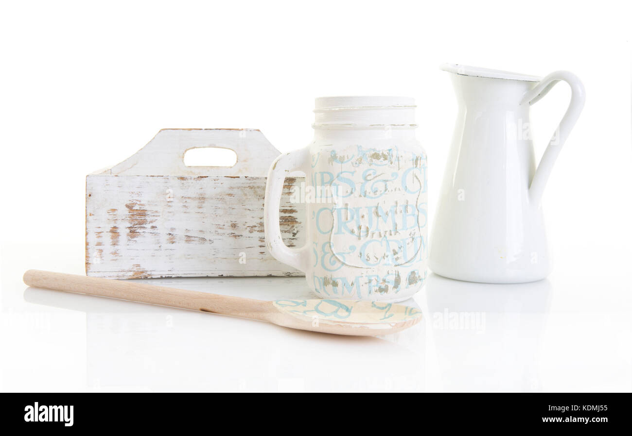 Blue and white shabby chic kitchen utensils on a white background - Stock Image