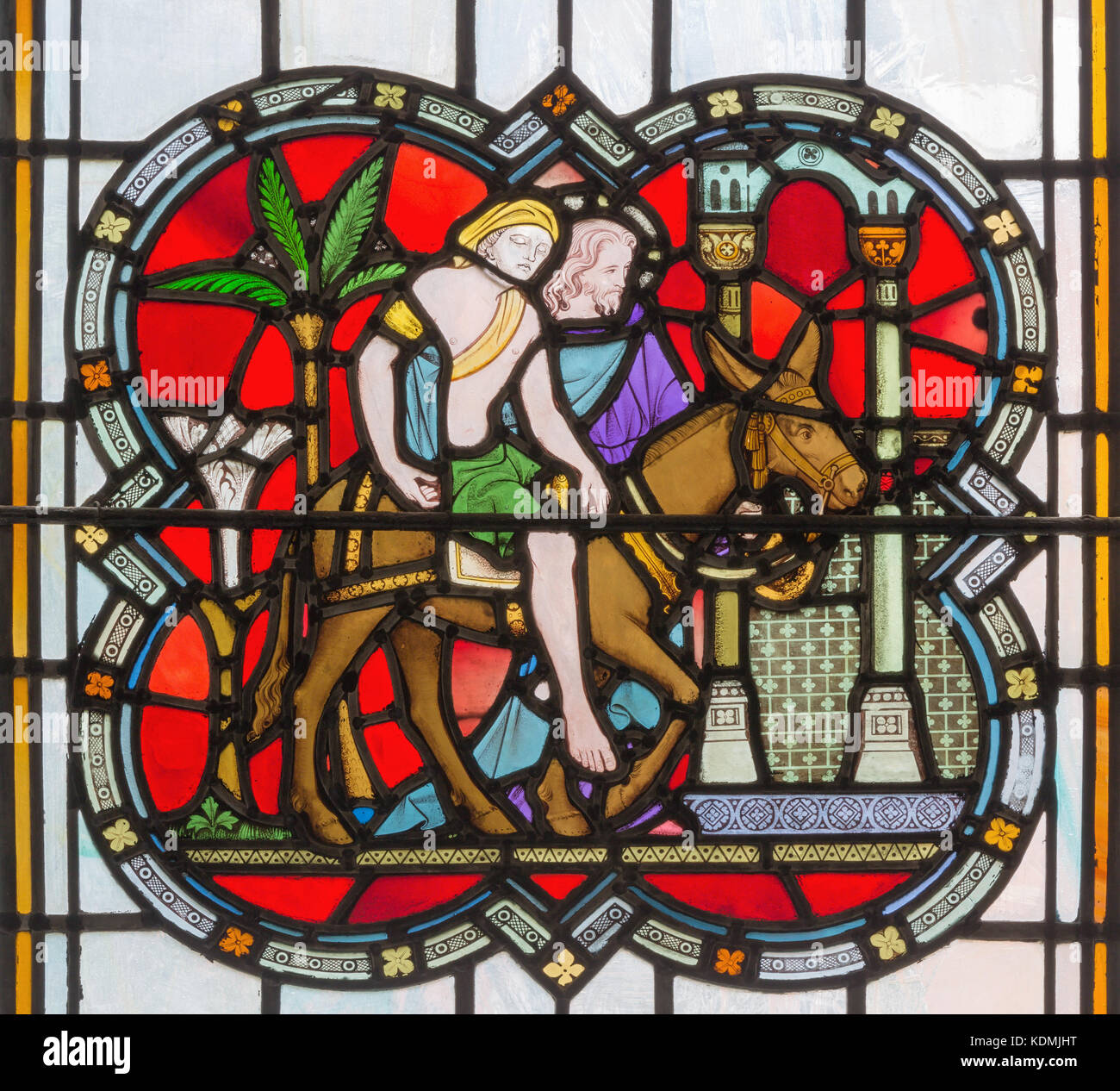 LONDON, GREAT BRITAIN - SEPTEMBER 14, 2017: The Parable of the Good Samaritan on the stained glass in the church - Stock Image
