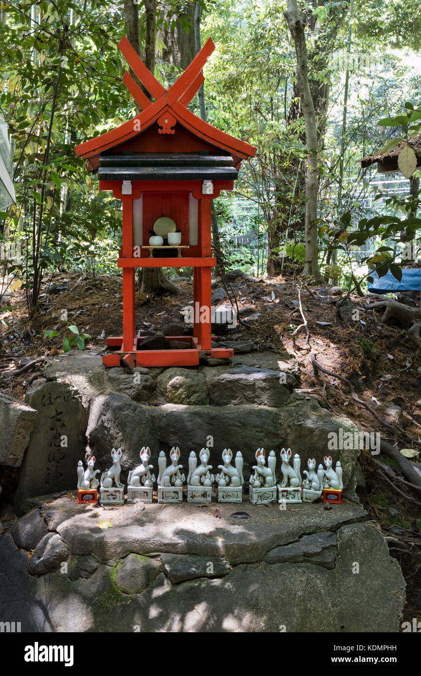 Kyoto, Japan - May 20, 2017: Traditional Kitsune, animal guardian in front of an Inari Shrine in Kyoto - Stock Image