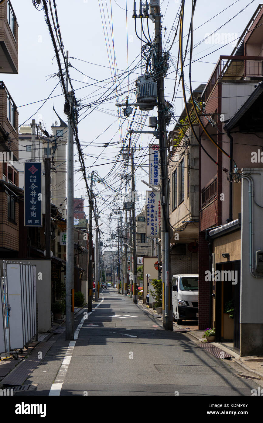 Kyoto, Japan - May 21, 2017: Japanese electricity pylon and cables overground in an alley in Kyoto - Stock Image