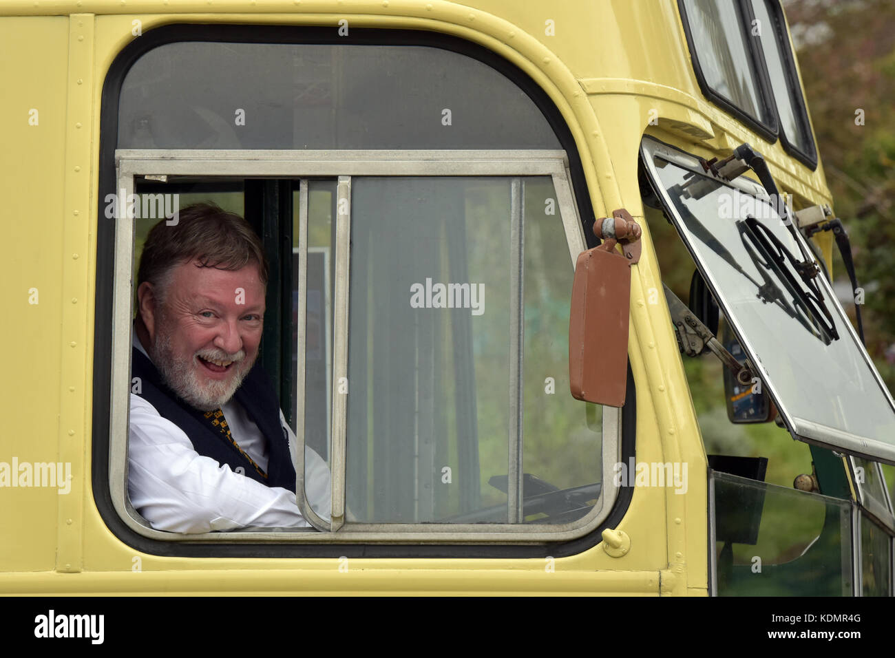 a vintage or collectors bus with the driver in the cab at a busses and beer event for bus and coach enthusiasts - Stock Image