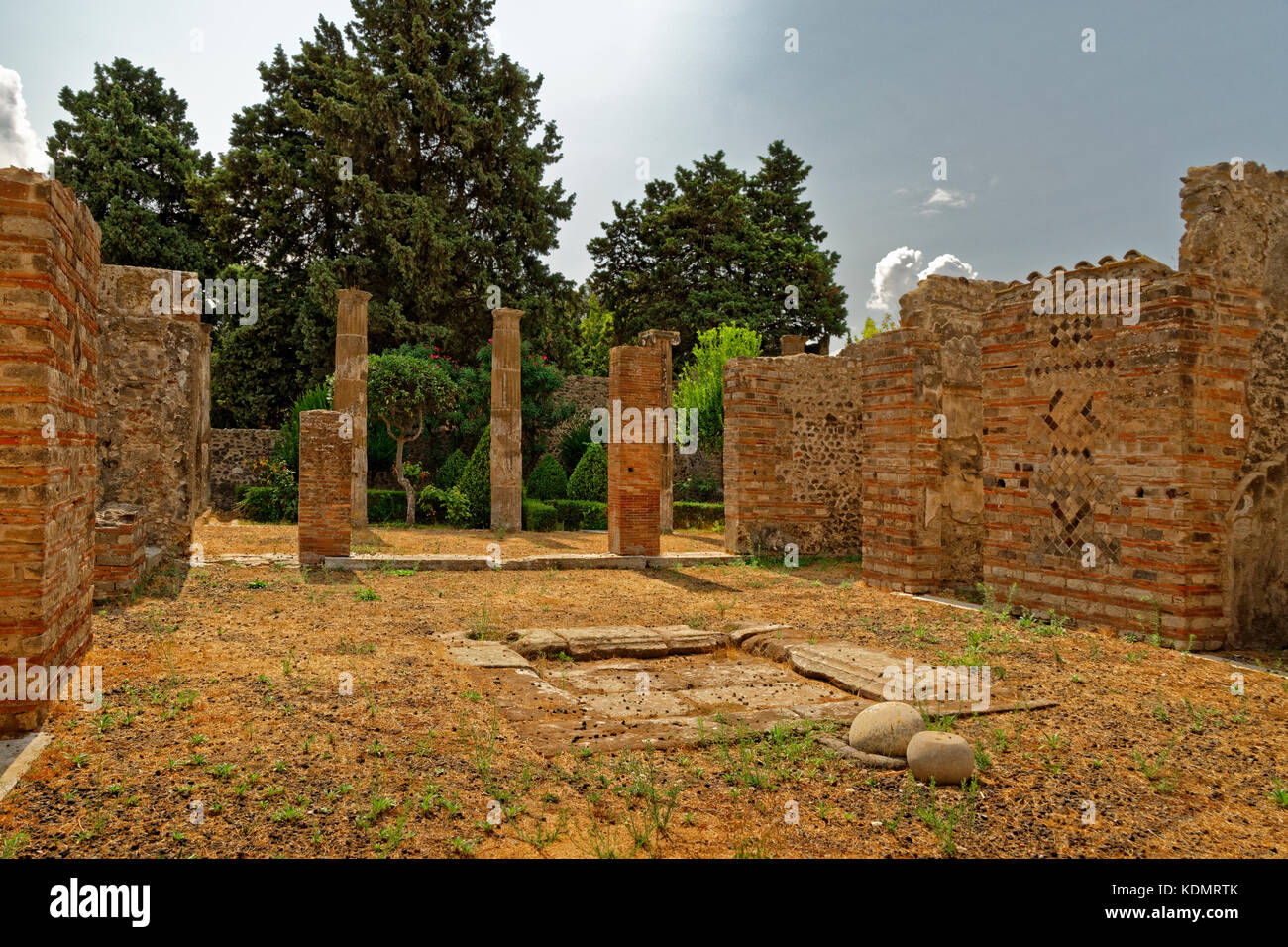 Villa courtyard in the ruined Roman city of Pompeii at Pompei Scavi, near Naples, Southern Italy. - Stock Image