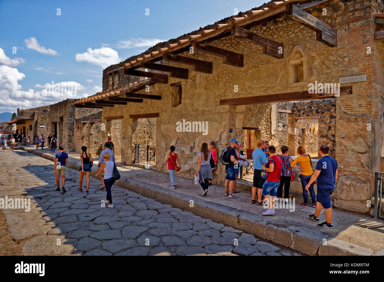 Street and cafe/shop in the ruined Roman city of Pompeii at Pompei Scavi, near Naples, Southern Italy. Stock Photo