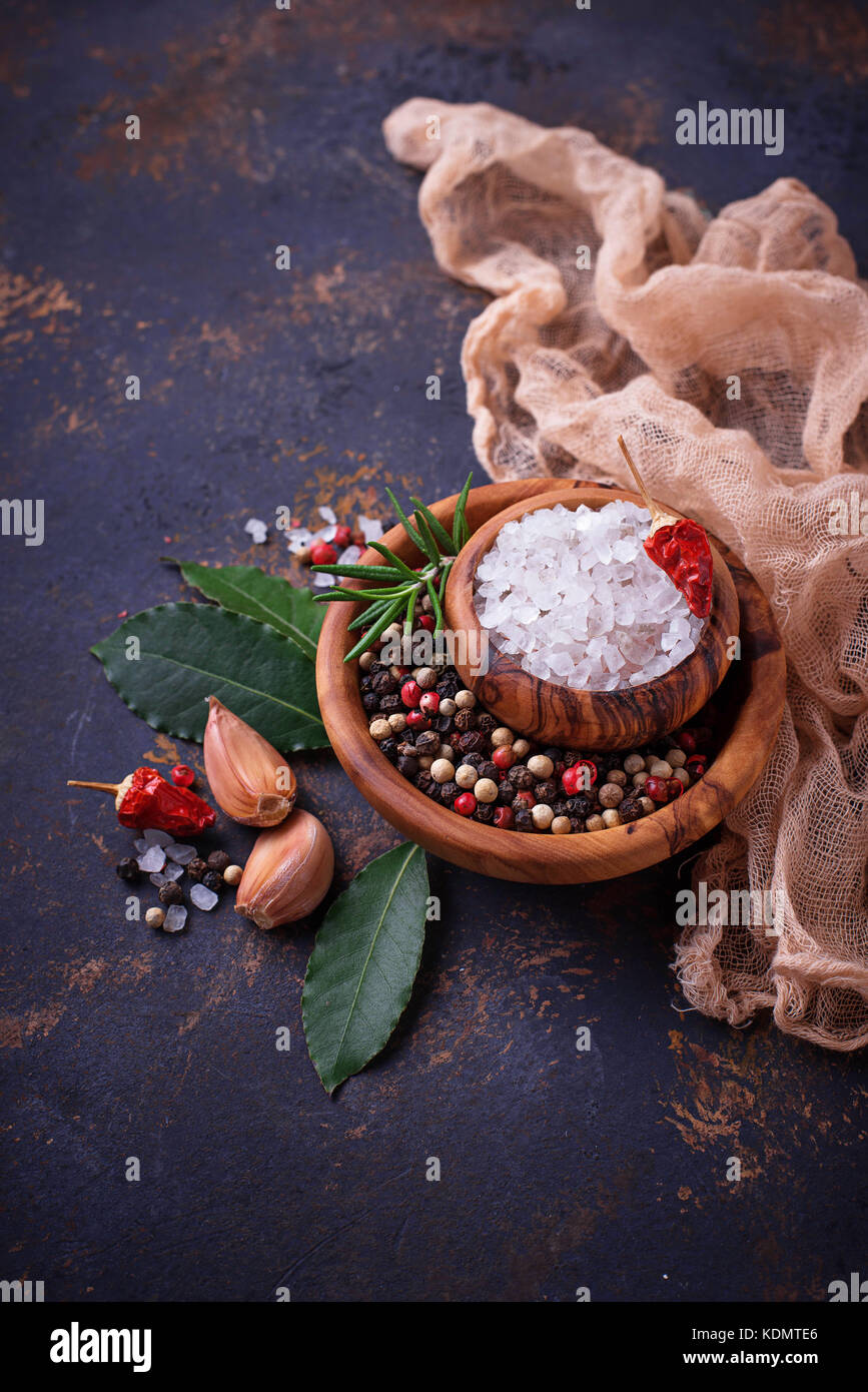 Herbs and spices on rusty background  - Stock Image