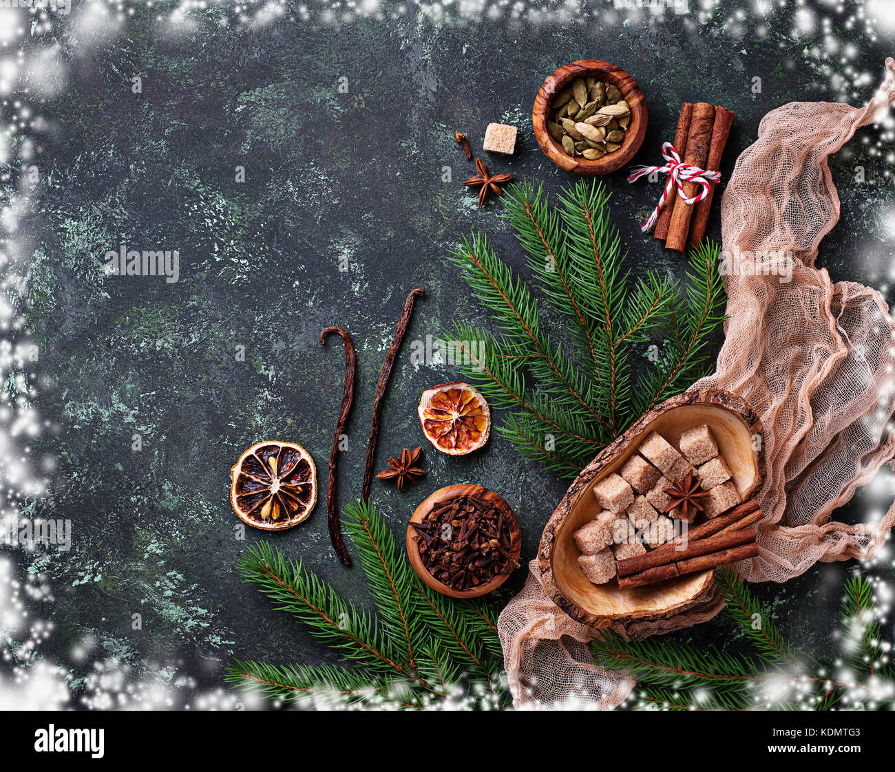 Traditional Christmas spices on green background. - Stock Image