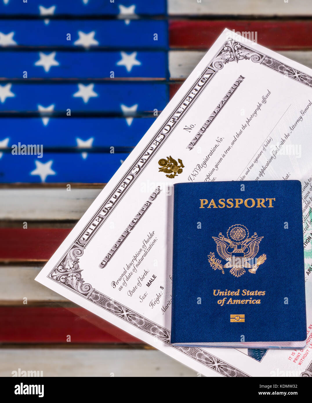 USA passport and naturalization certificate over US Flag - Stock Image