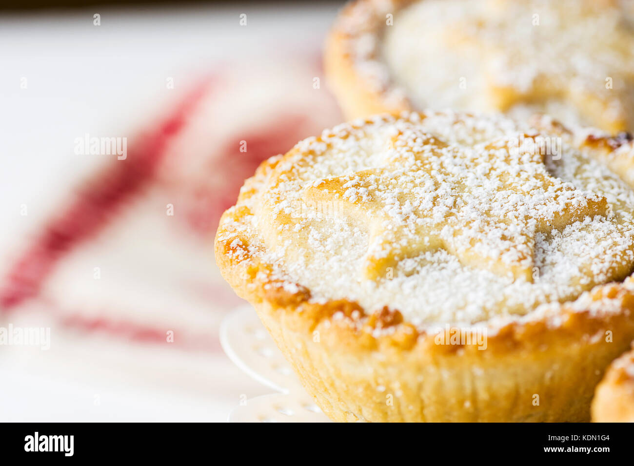 Traditional British Christmas Pastry Dessert Home Baked Mince Pies with Apple Raisins Nuts Filling on White Elegant - Stock Image