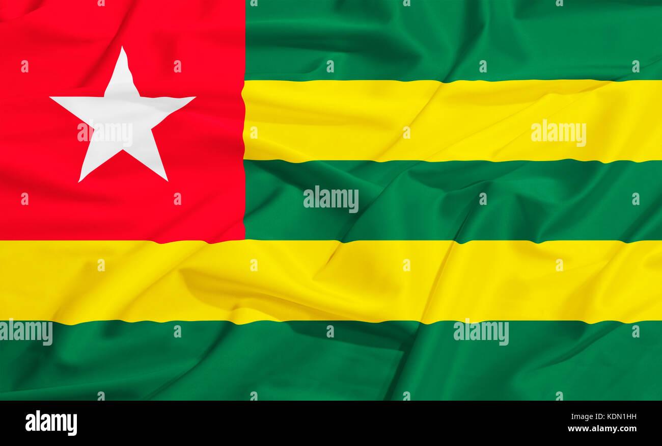 Togo flag on a silk drape waving - Stock Image