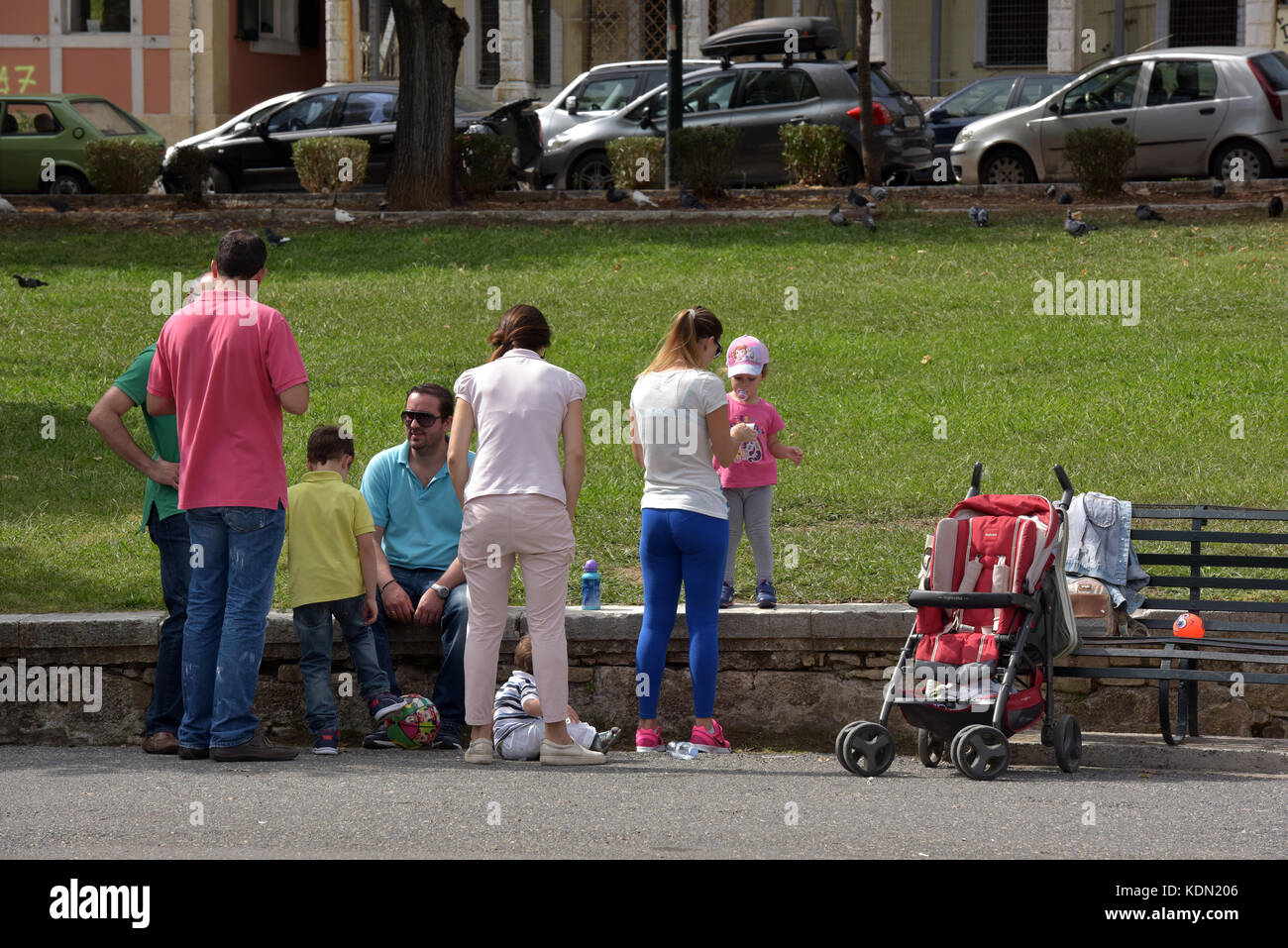 a large and extended family meeting in the park for a families gathering at the weekend in Kerkira, Greece on corfu - Stock Image