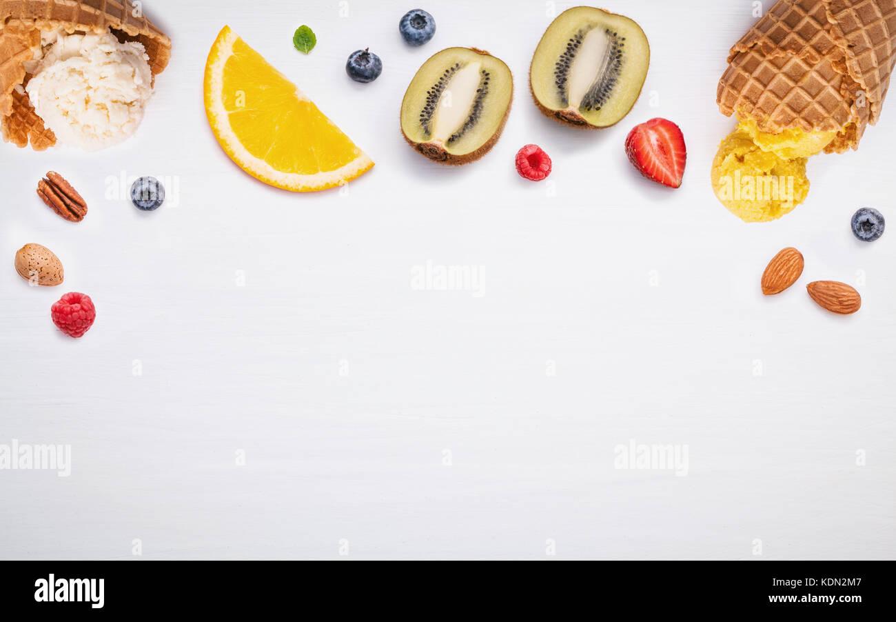 Cones and colorful various fruits raspberry ,blueberry ,strawberry ,orange slice , halve kiwi ,apple,tomato and - Stock Image