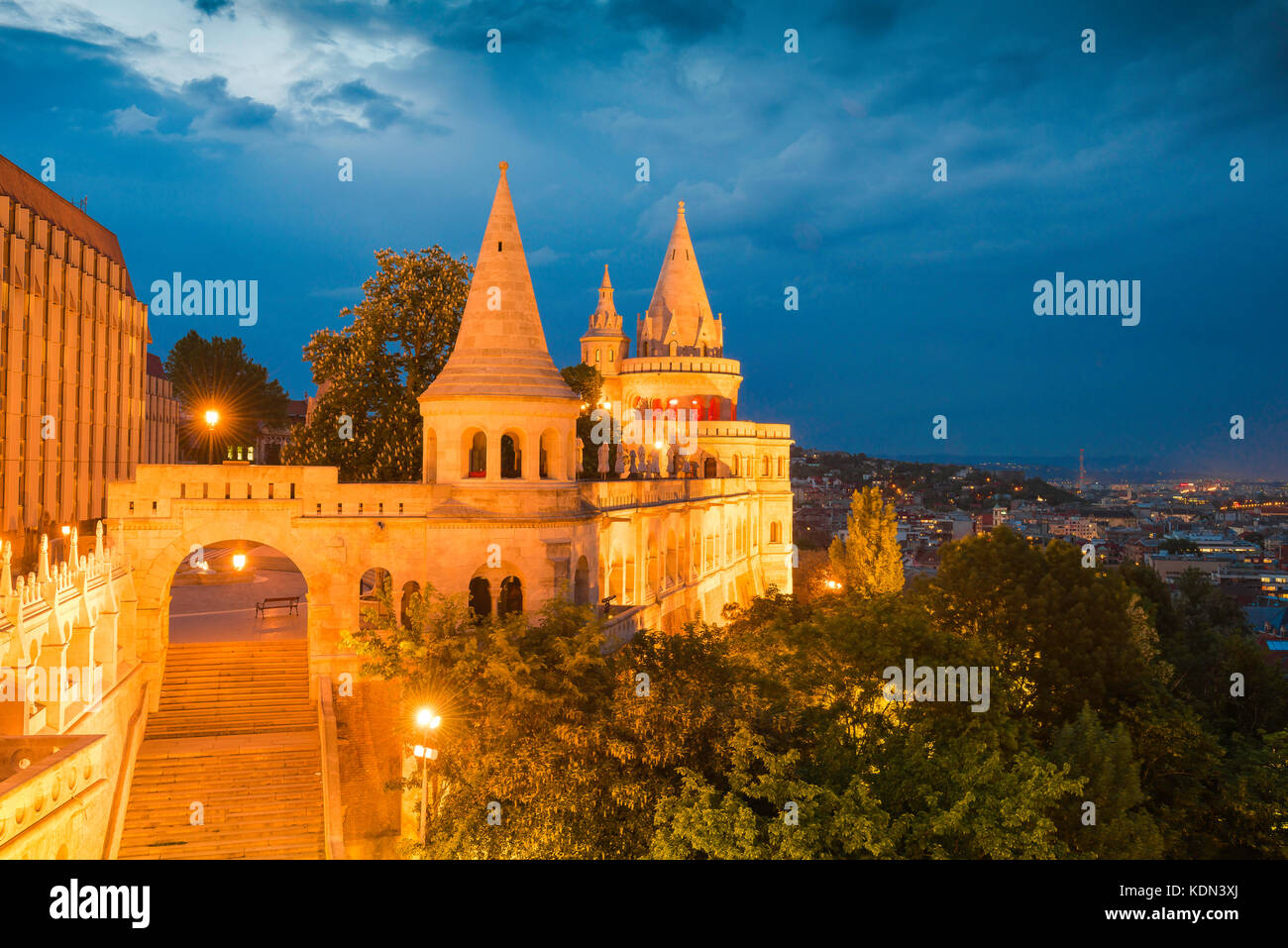 Budapest Fishermans Bastion,view of a turreted section of the Fishermans Bastion at night illuminated by floodlights, - Stock Image