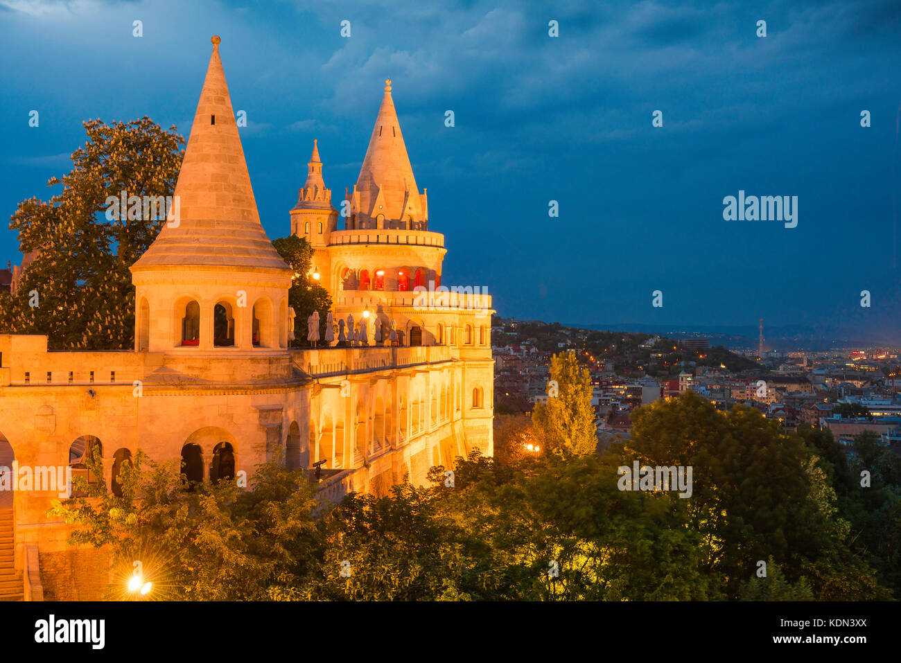 Budapest Fishermens Bastion, view of a turreted section of the Fishermen's Bastion at night illuminated by floodlights, Stock Photo
