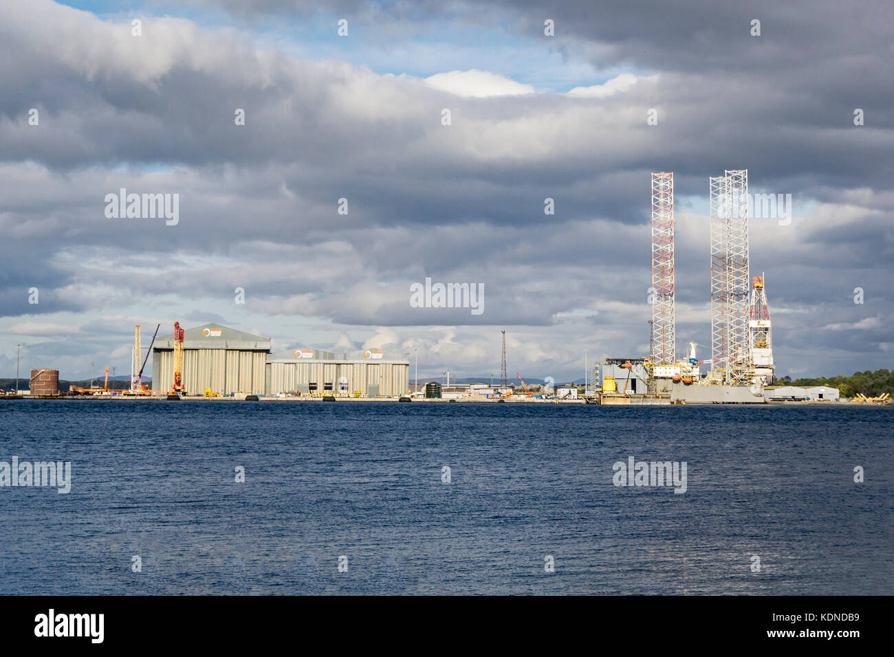 Global Energy at Nigg Energy Park Port of Nigg Highland Scotland UK viewed from Cromarty on the Black Isle. - Stock Image
