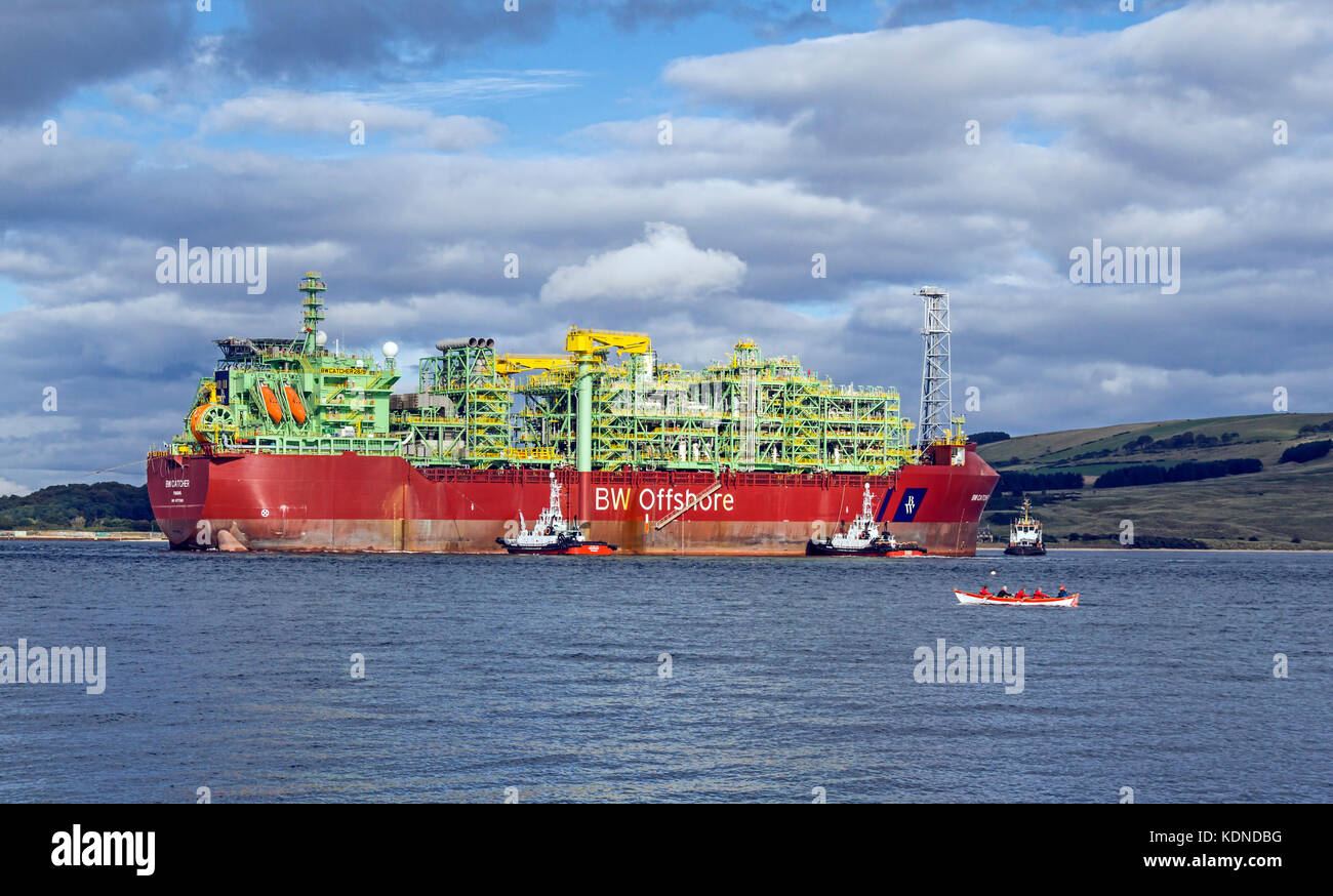 Premier Oil's floating production storage and offloading (FPSO) vessel BW Catcher preparing to berth at the - Stock Image