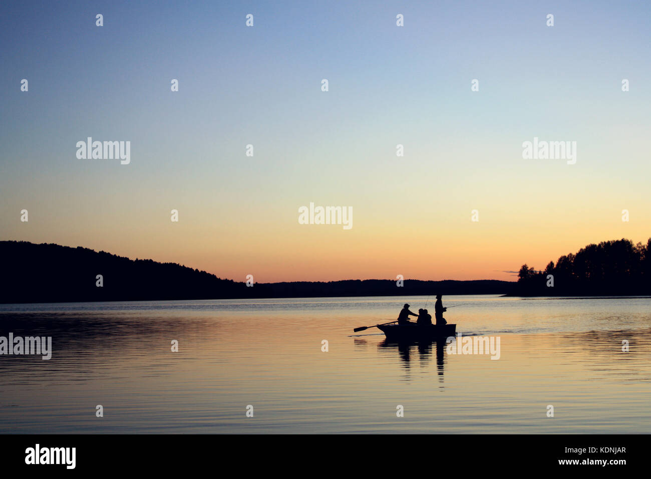 The Boat with fishermen. Sunset on the Kenozero lake. Late evening. White nights on the north of Russia. Peaceful - Stock Image