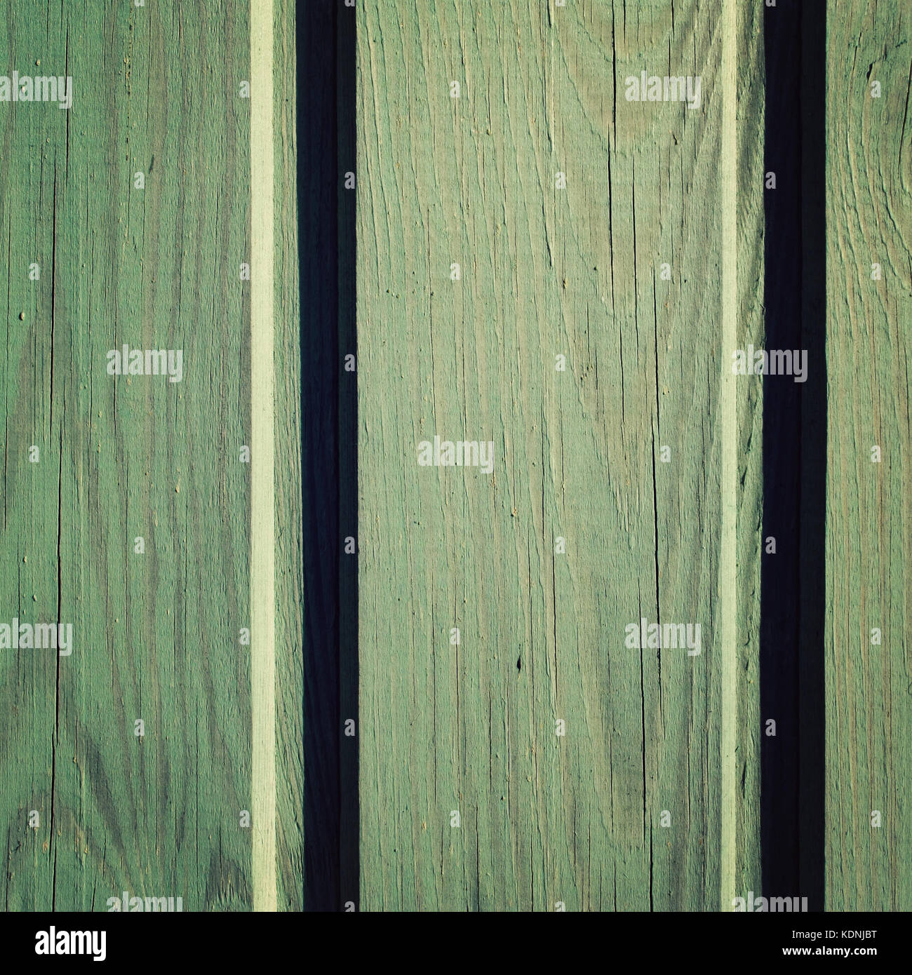 Green wooden background. Painted texture. Colorful wall. Close up photo. Toned image. - Stock Image