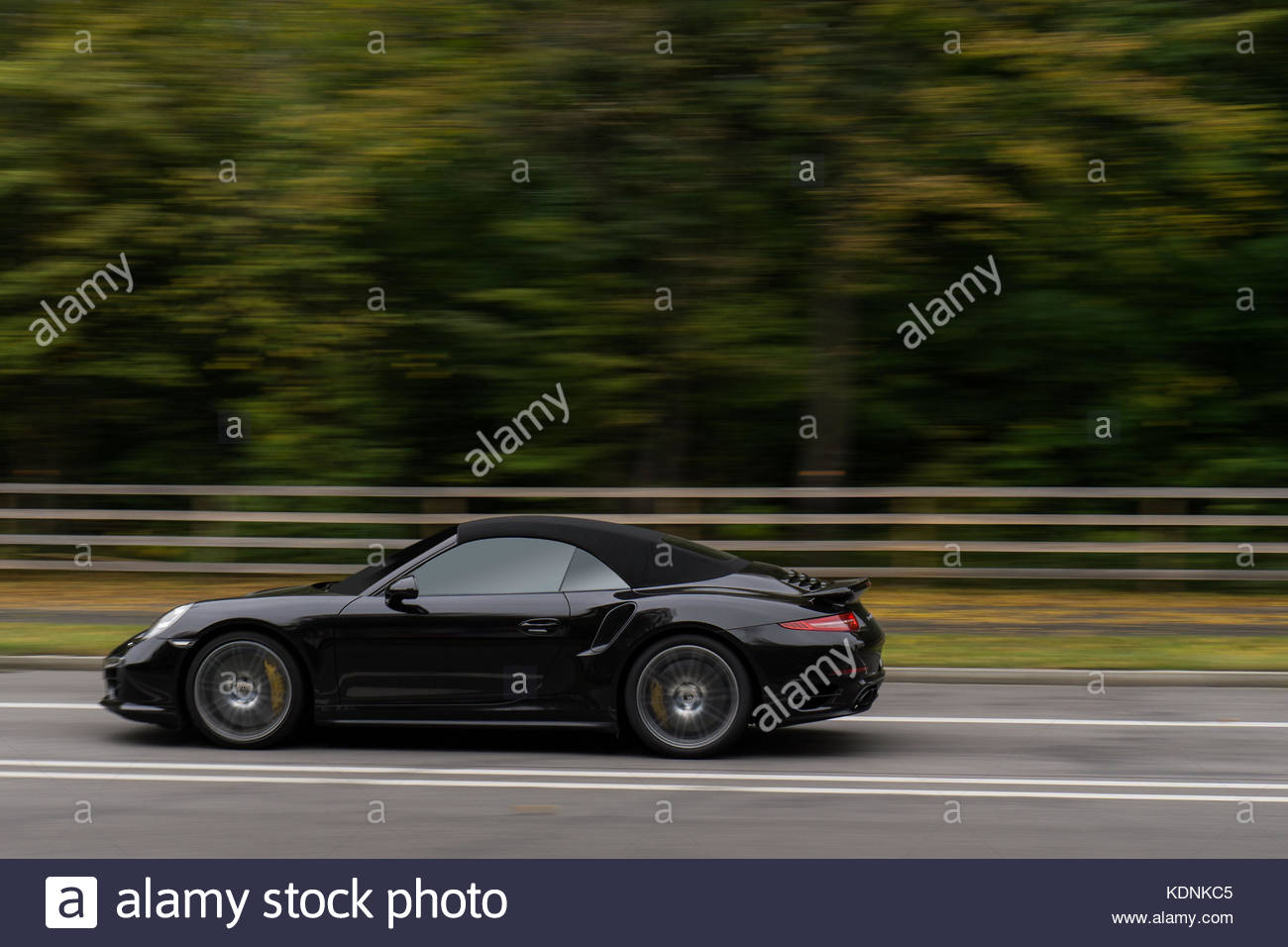 Black Cabrio on Country Road - Stock Image