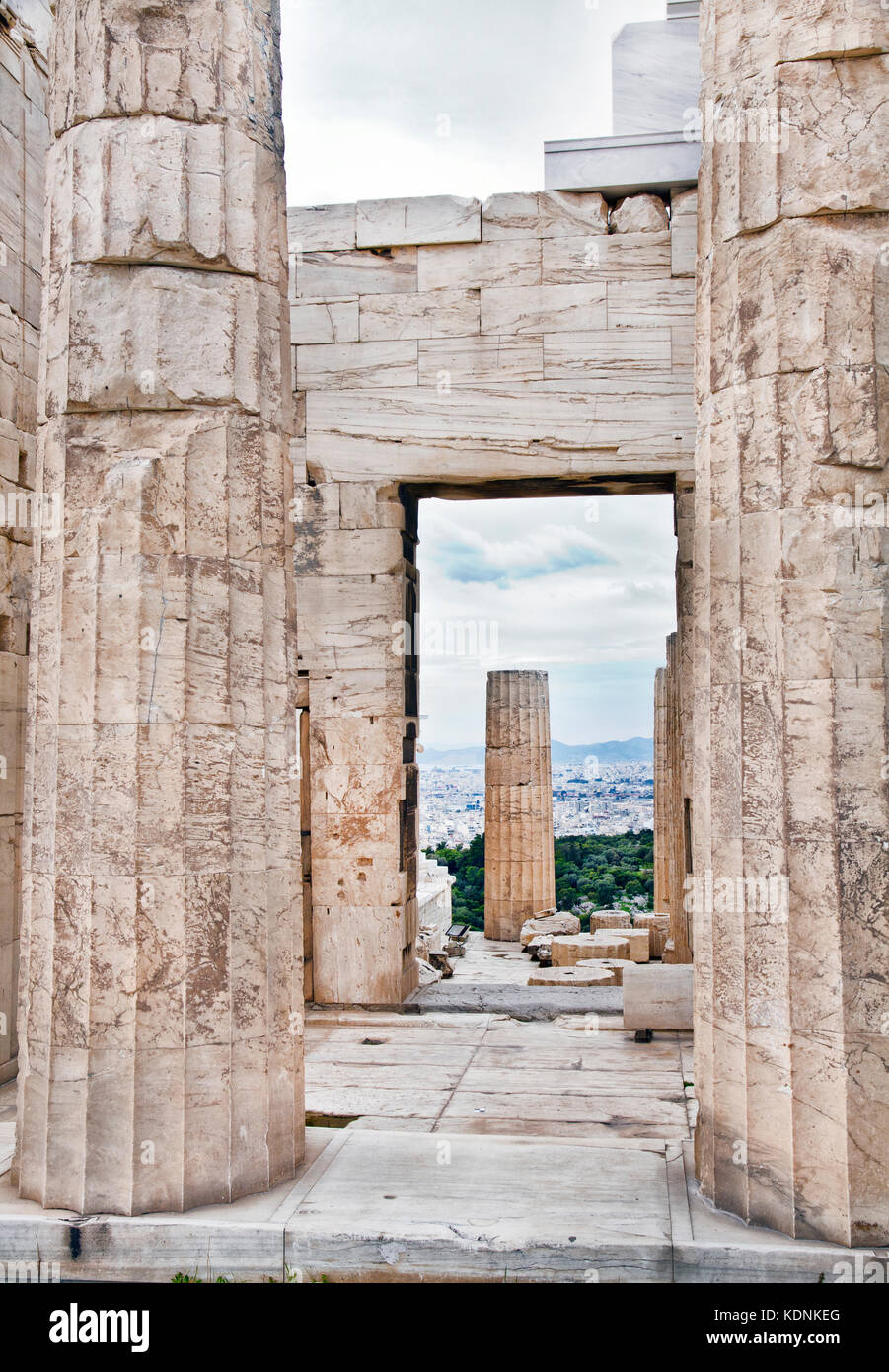 Marble remains of walls and columns  located in the Acropolis of Athens. - Stock Image