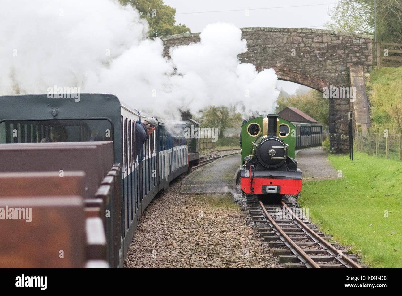 Ravenglass and Eskdale Steam Railway, Cumbria, England - steam and diesel engines pass on the 15' gauge railway - Stock Image
