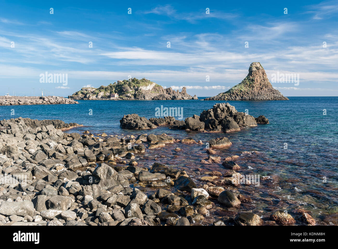 Island Lachea and a sea stack, geological features in Acitrezza (Sicily) - Stock Image