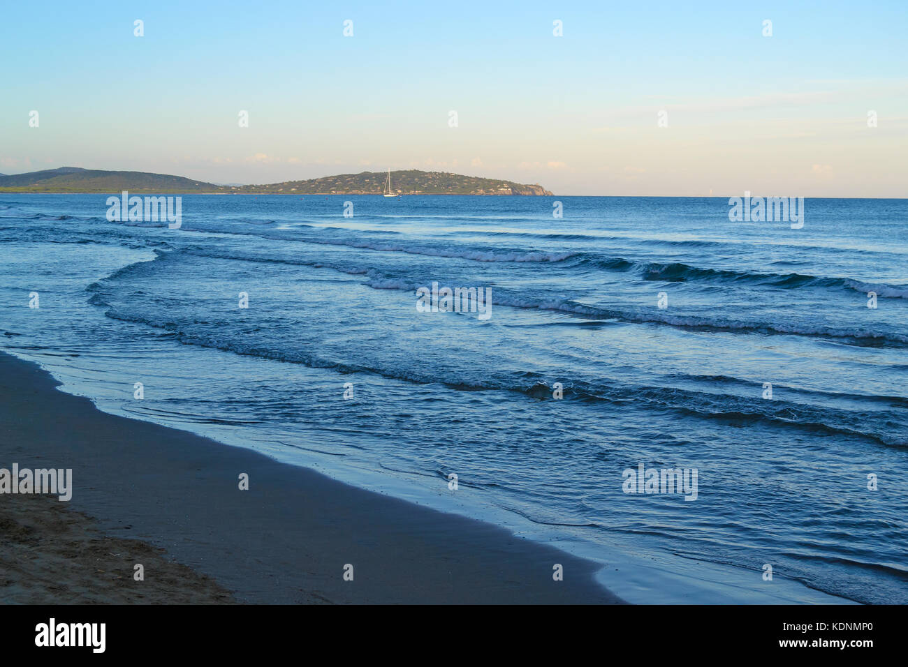 day of peace and relaxation on the beach of Porto Ercole watching the sea, Monte Argentario, Italy - Stock Image
