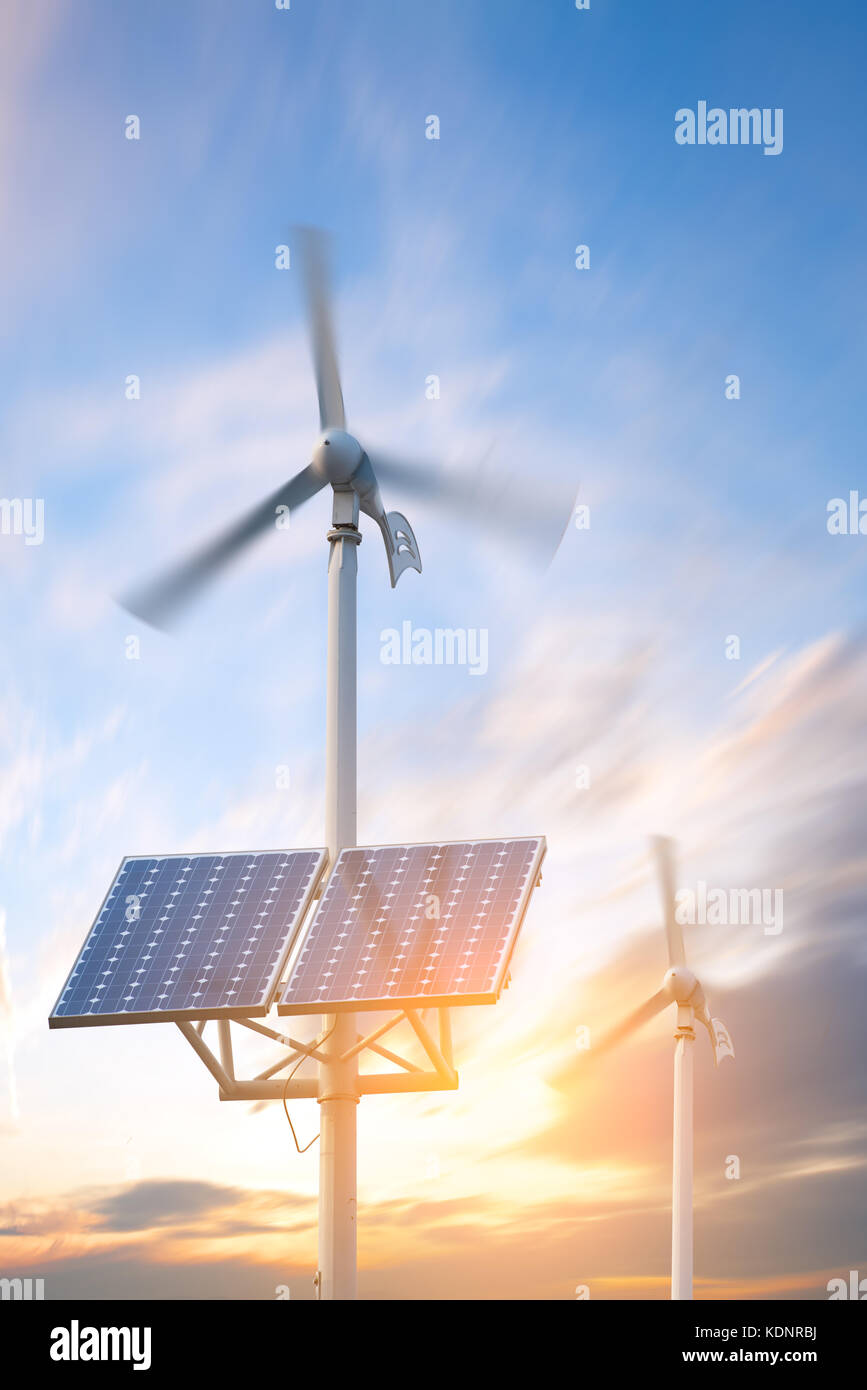 solar panels and wind turbines against city on background