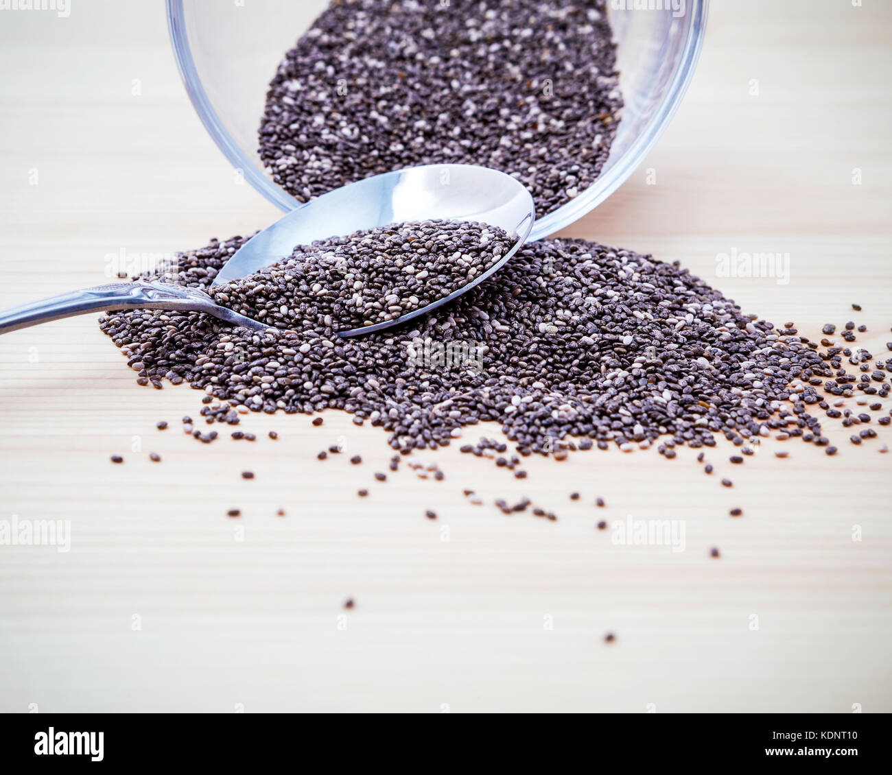 Nutritious chia seeds in glass bowl on wooden table for diet foods ingredients . Nutritious Foods and Super foods - Stock Image