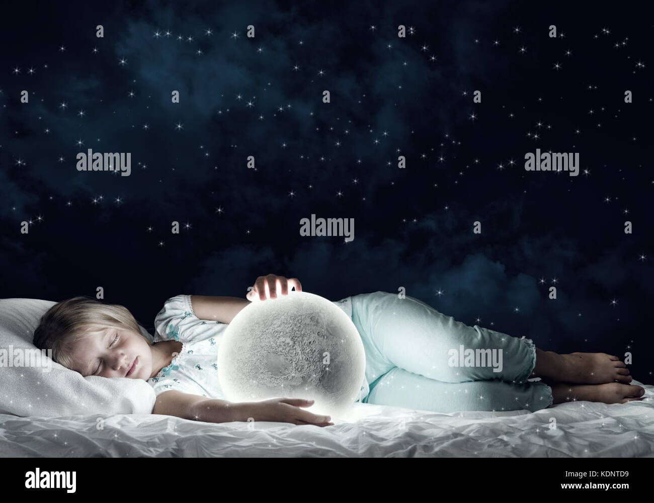 Girl in her bed and moon planet - Stock Image