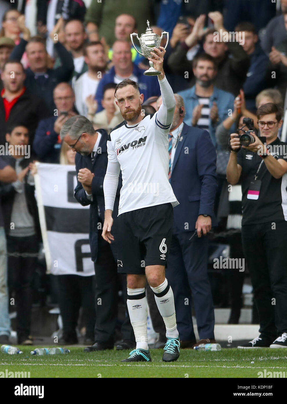 Derby County's Richard Keogh holds the Brian Clough Trophy during the Sky Bet Championship match at Pride Park, - Stock Image