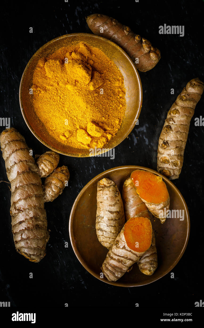 turmeric root and powder - Stock Image