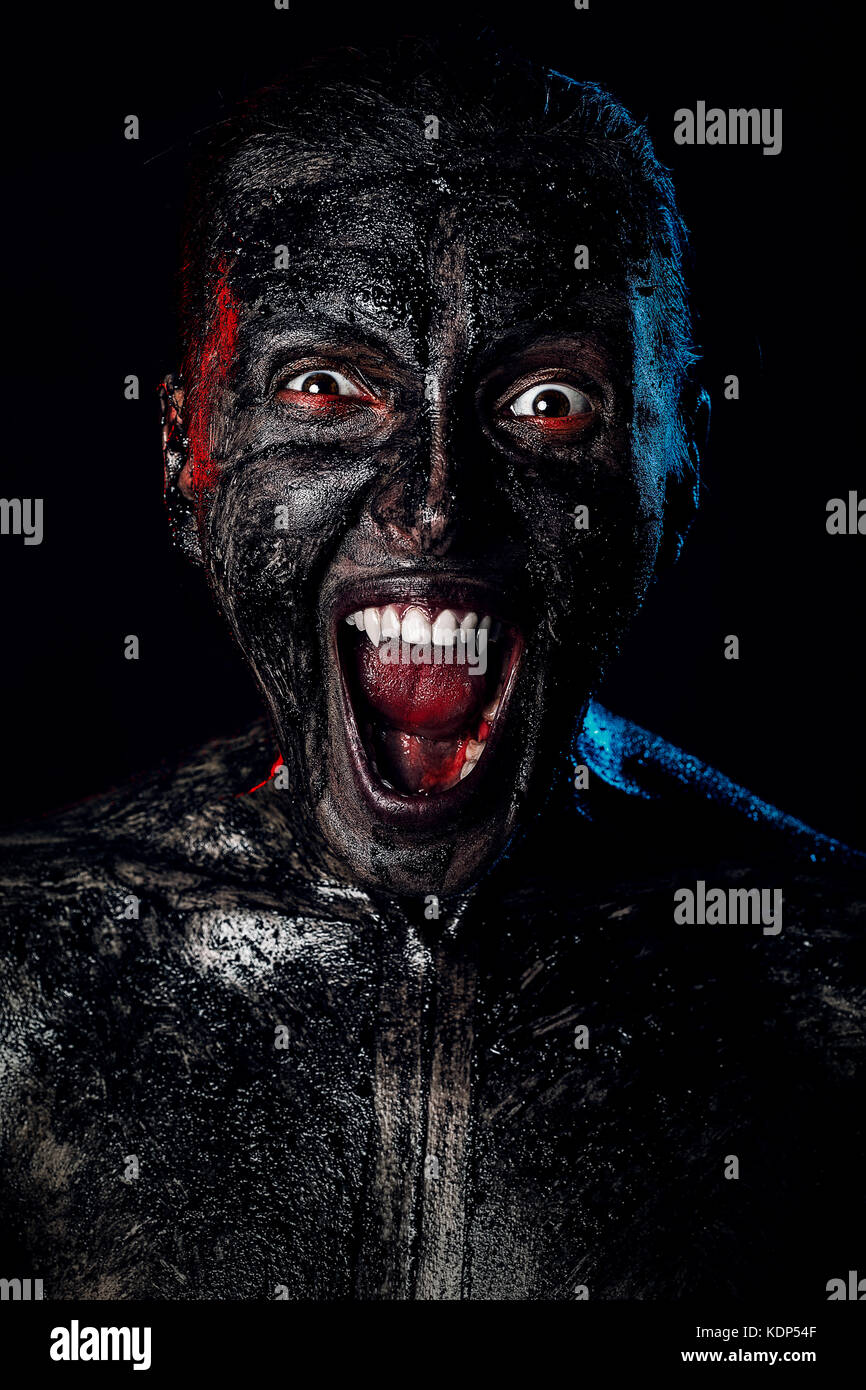 angry dirty vampire attack on black background - Stock Image