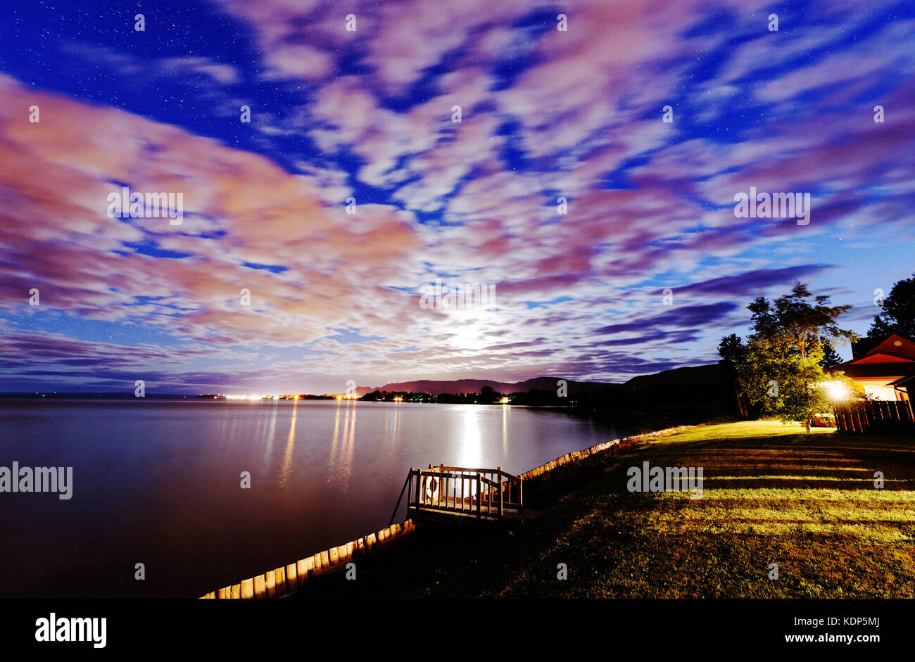 A superb night sky over Maria in Baie des Chaleurs in Gaspesie, Quebec, Canada - Stock Image