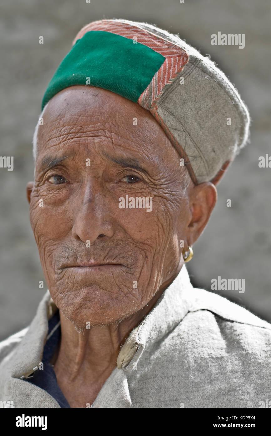 Portrait of a Lahauli Man wearing a Pahari Topi, Keylong, Lahaul and Spiti Region, Northern India - Stock Image