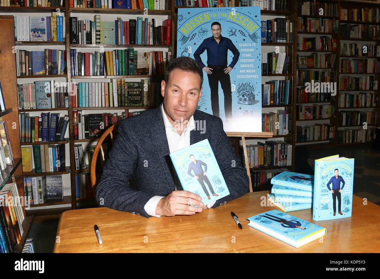 HUNTINGTON, NY-OCT 10: Jeff Rossen signs copies of his book, 'Rossen to the Rescue: Secrets to Avoiding Scams, - Stock Image