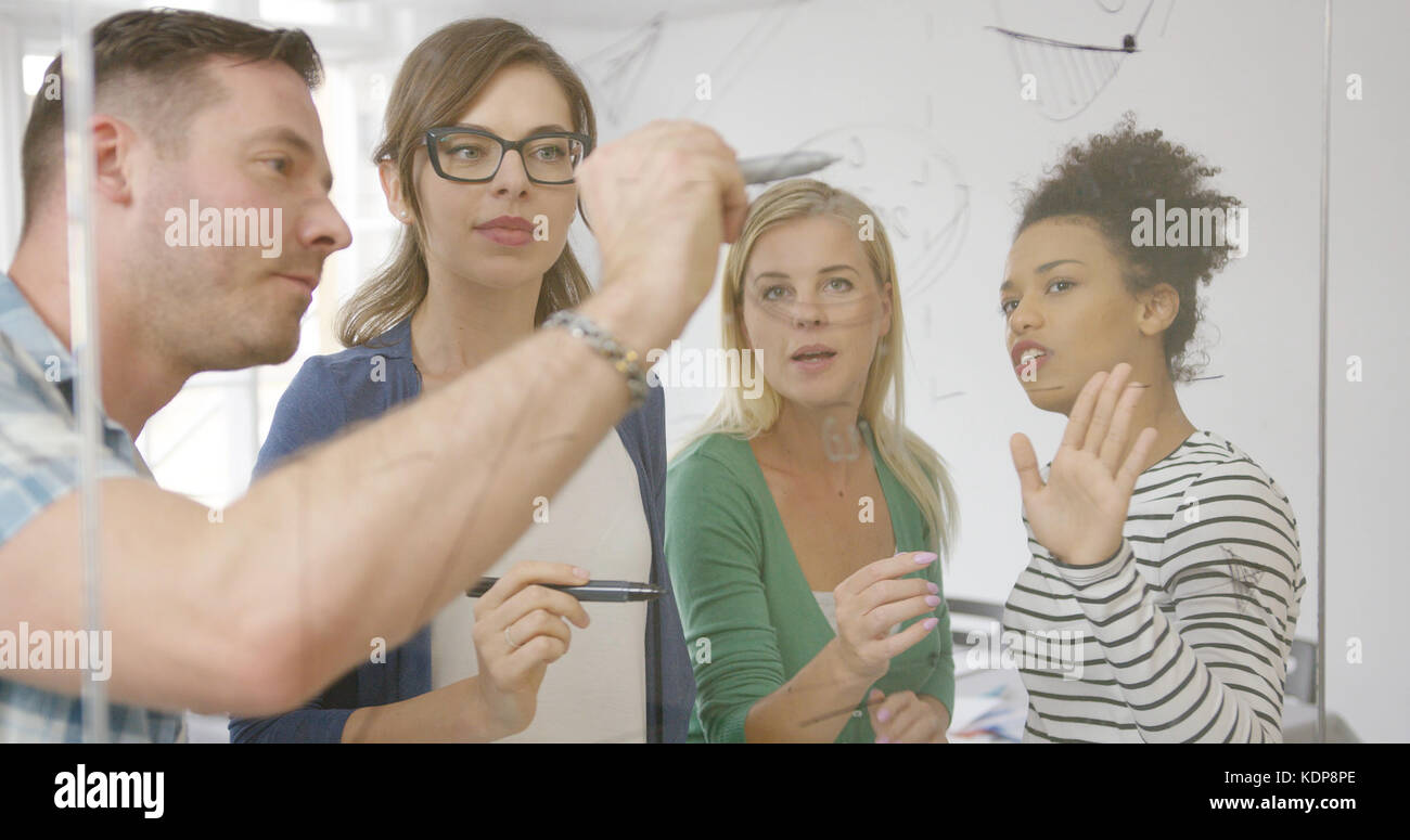 Coworkers in process of creation  - Stock Image